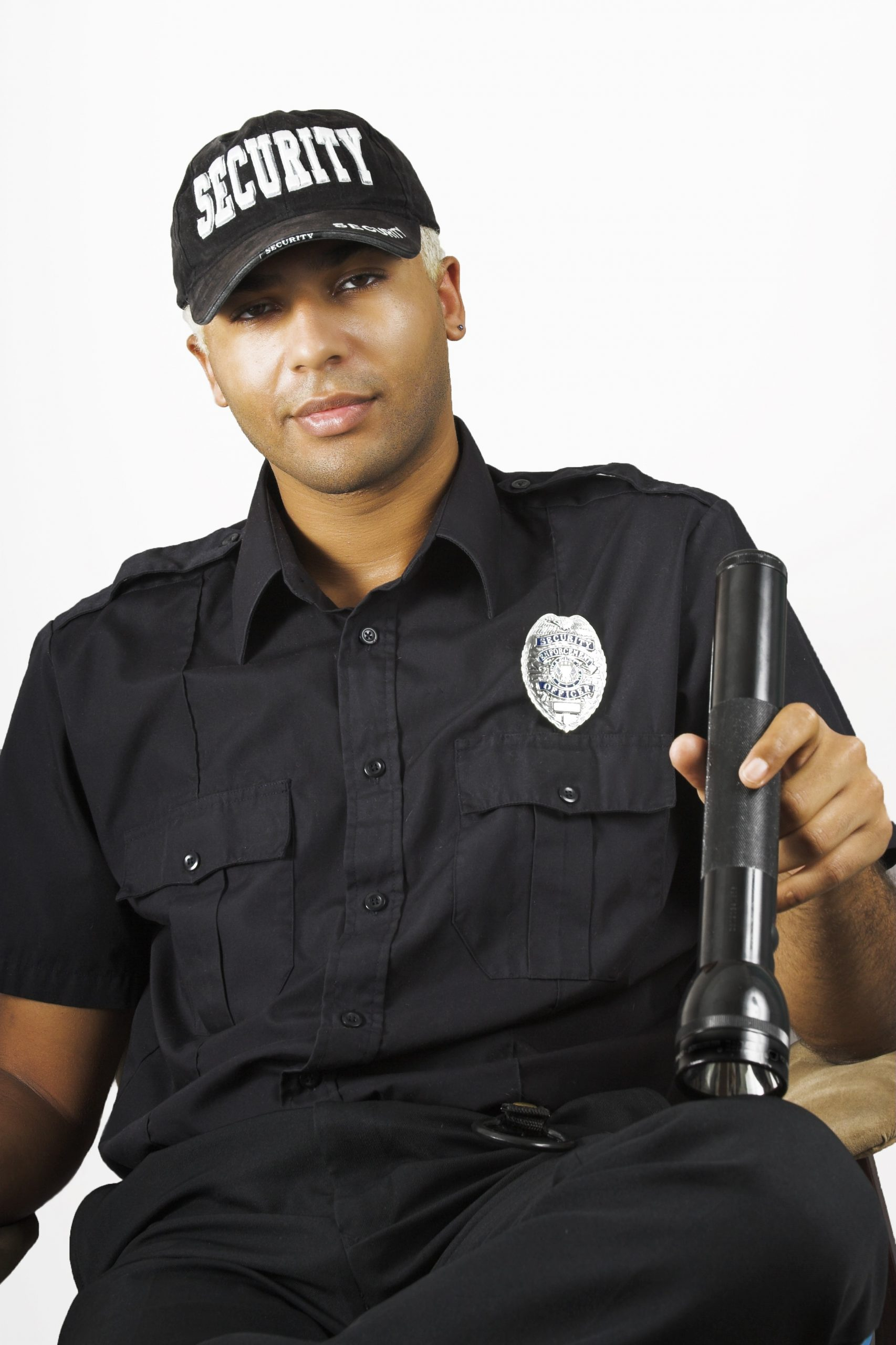 Security Guard holding a flashlight